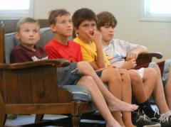Young Men listening intently to the Talk