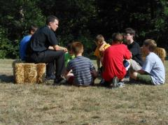 Seminarians Dcn. Thomas Haan and Michael Block sitting in Small Groups