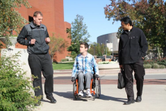 Two Seminarians speaking with a student on campus